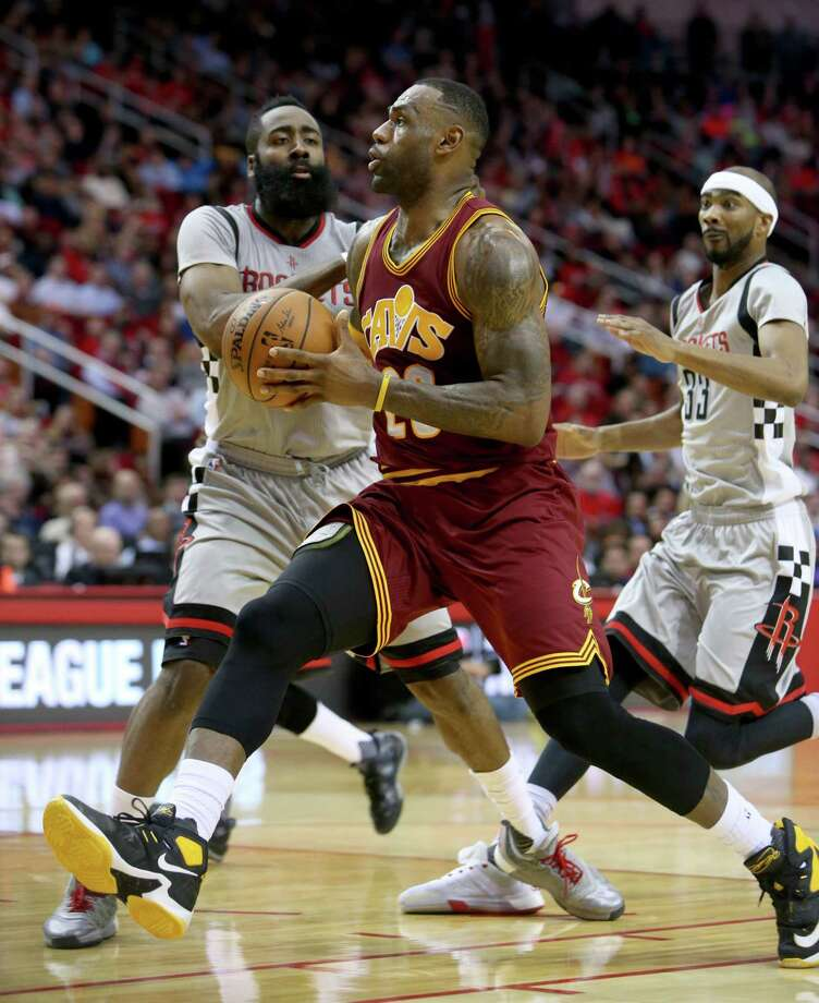 LeBron James is a crowd pleaser on the road, but will he suit up to face James Harden and the Rockets on Sunday at Toyota Center? Photo: Gary Coronado, Staff / © 2015 Houston Chronicle