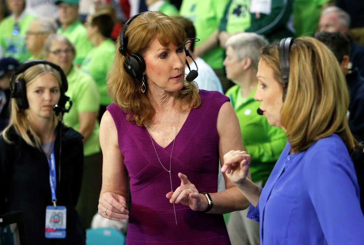 In this Sunday, March 5, 2017 photo, Debbie Antonelli, center, a women's college basketball analyst for ESPN, talks with play-by-play announcer Beth Mowins, right, before the start of the women's basketball game between Duke and Notre Dame at the NCAA college basketball game in the championship of the Atlantic Coast Conference tournament at the HTC Center in Conway, S.C. Antonelli will be first woman to broadcast menÂ?'s NCAA Tournament games in over two decades. SheÂ?'s no stranger to the menÂ?'s game or its fans, doing ACC games for the past six years. (AP Photo/Mic Smith)
