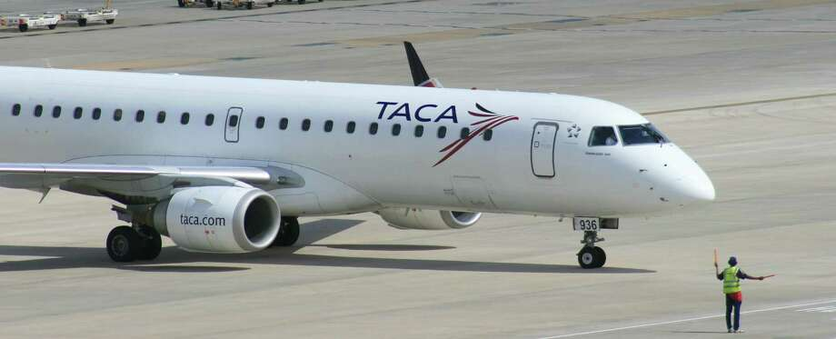 A Taca jet taxis at Bush Intercontinental Airport. The Houston Airport System's overall passenger count slipped 1.2 percent last year. Photo: Bill Montgomery