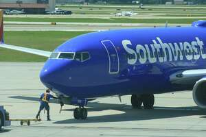 Workers prepare a Southwest Airlines flight for departure at Houston' Hobby Airport in May 2016.