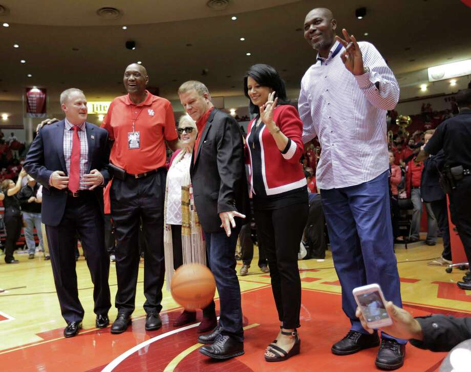 Among the UH dignitaries on hand for Sunday's final game at Hofheinz Pavilion were from left, athletic director Hunter Yurachek, former Cougars basketball great Elvin Hayes, Dene Hofheinz (daughter of arena namesake Judge Roy Hofheinz), board of regents chairman Tilman Fertitta, school president Renu Renu Khator, and Phi Slama Jama member Hakeem Olajuwon. ( Elizabeth Conley / Houston Chronicle ) Photo: Elizabeth Conley, Staff / © 2017 Houston Chronicle