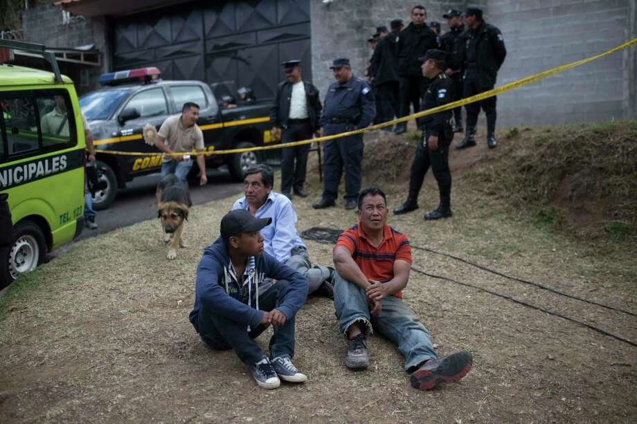 Relatives wait outside the Virgen de la Asuncié³n children's shelter, in San Jose Pinula, Guatemala, on Wednesday, March 8, 2017. At least 19 people have been found dead after a fire at the shelter, which was created to house children who were victims of abuse, homelessness or who had completed sentences at youth detention centers and had nowhere else to go, the spokesman for Guatemala's volunteer fire departments said. (AP Photo / Luis Soto) Photo: Luis Soto, STR / Copyright 2017 The Associated Press. All rights reserved.