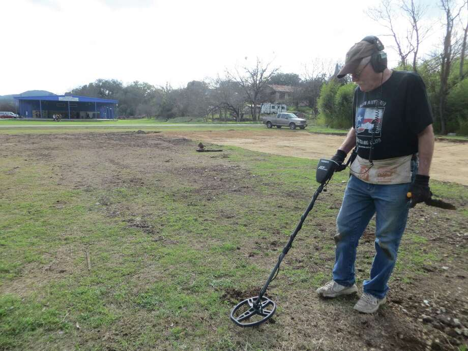 """Jerry Osborn went """"dirt fishing"""" with a metal detector Monday March 6 2017 at the Bandera site where a new skate park is planned for construction. At rear is the Bandera Boys and Girls Club. Photo: Zeke MacCormack / Staff"""