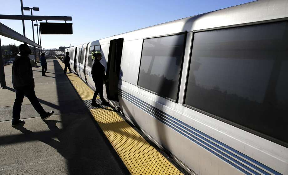 In this file photo, passengers board a train at the Castro Valley BART station. Photo: Michael Macor, The Chronicle
