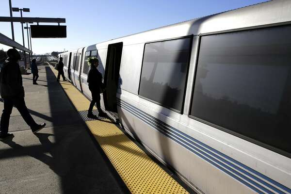 Passengers board a trian at the Castro Valley BART station on Wed. March 8, 2017, in Castro Valley, Ca.