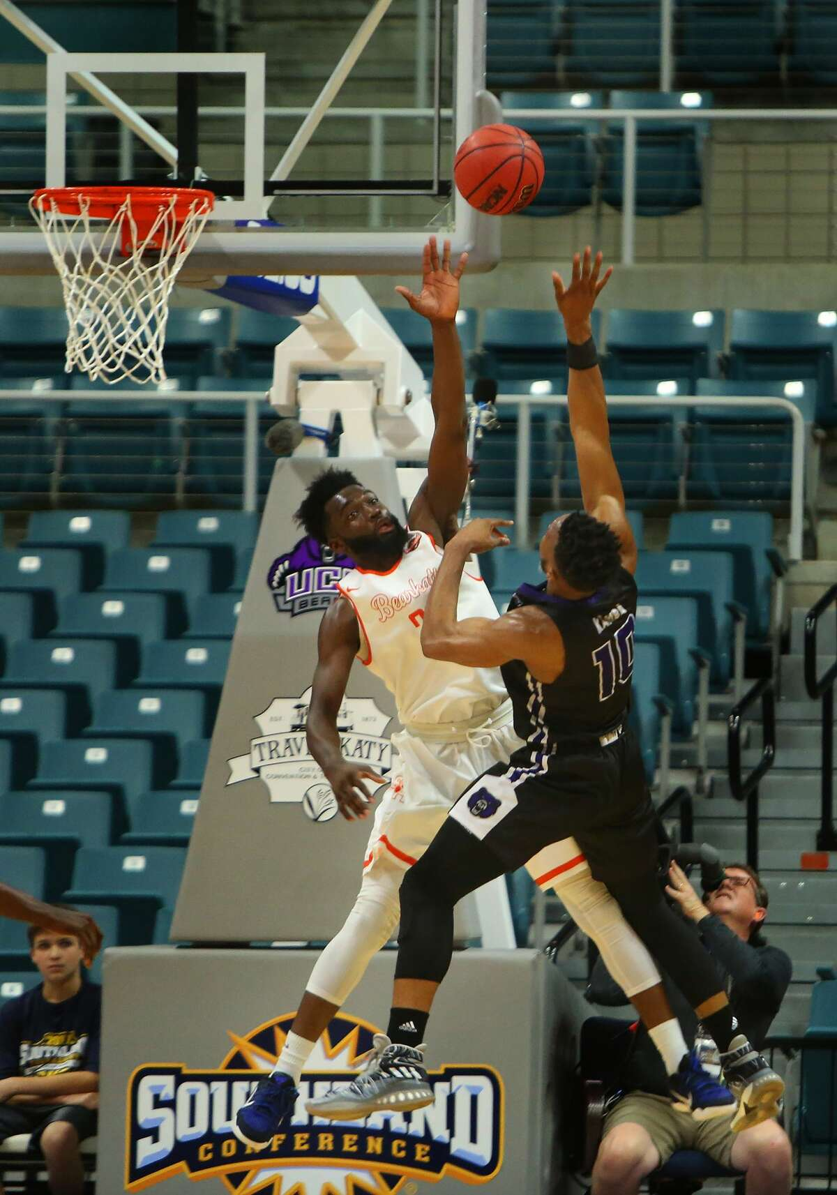 Sam Houston guard Dakarai Henderson tries to block a shot by Central Arkansas guard Mathieu Kamba during a Sam Houston State University Bearkats win over the Central Arkansas University Bears in the first round of the 2017 Southland Conference Men's Basketball Tournament at the Merrell Center, Wednesday, March 8, 2017, in Katy. ( Mark Mulligan / Houston Chronicle )