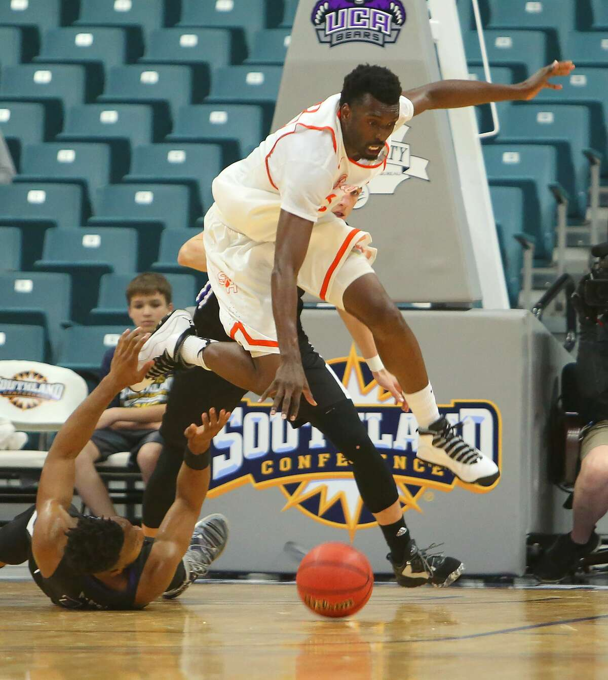 Sam Houston forward Chris Galbreath, Jr., leaps for a loose ball during a Sam Houston State University Bearkats win over the Central Arkansas University Bears in the first round of the 2017 Southland Conference Men's Basketball Tournament at the Merrell Center, Wednesday, March 8, 2017, in Katy. ( Mark Mulligan / Houston Chronicle )