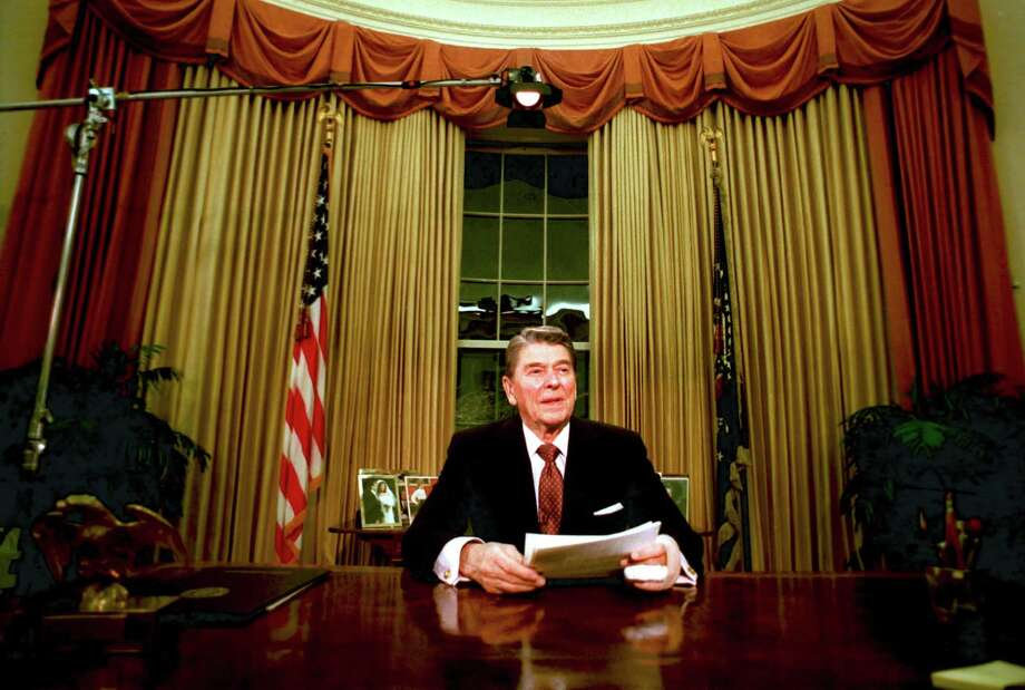 Departing U.S. President Ronald Reagan is seen shortly after he delivered his farewell address to the nation at the Oval Office, Jan. 12, 1989. A reader quotes Reagan and raises the question: How do Americans view the nation today? Photo: RON EDMONDS /AP / AP