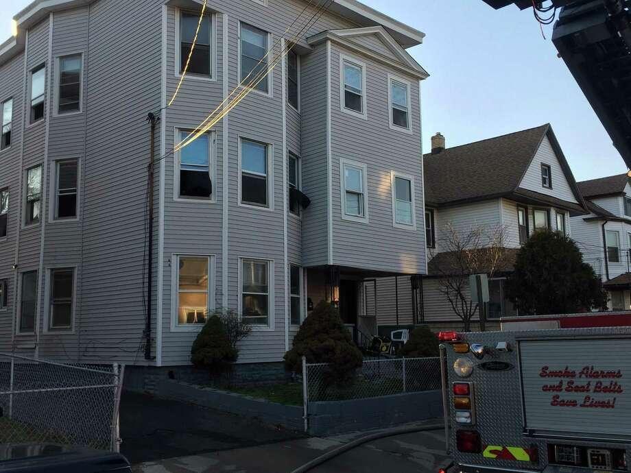475 Logan Street in Bridgeport after firefighters take down blaze on the second floors. Photo: /Aaron Johnson