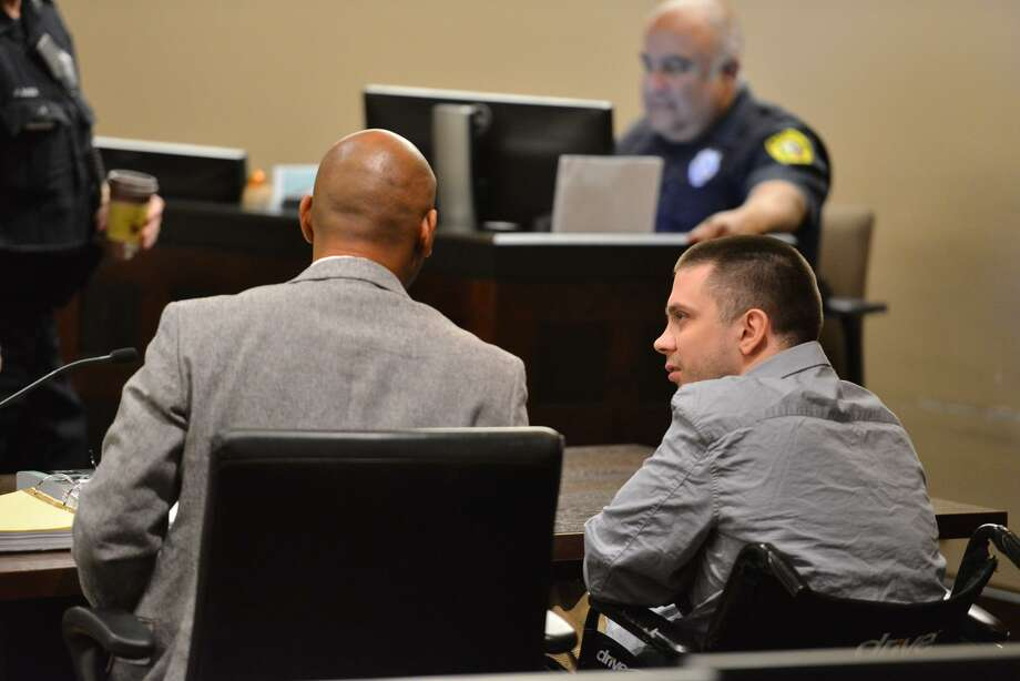 Benjamin Poehlmann (right) who is accussed of fatally shooting his girlfriend on Christmas Day 2014, talks to his attorney David Andre Woodard as his trial got underway Wednesday in Judge Steven C. Hilbig in the 187th State District Court. Photo: Robin Jerstad, Freelance / San Antonio Express News