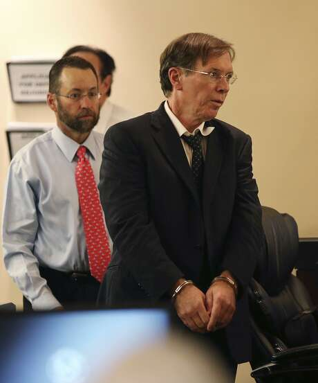Dr. Calvin Day, right, walks back into the Bexar County 379th District Court during the punishment phase of his sexual assault trial, Monday, June 24, 2013. Day convicted of sexually assaulting a patient but later won a new trial and dismissal of the case. In back is one of his attorneys, Jay Norton. Photo: Jerry Lara /San Antonio Express-News / ©2013 San Antonio Express-News