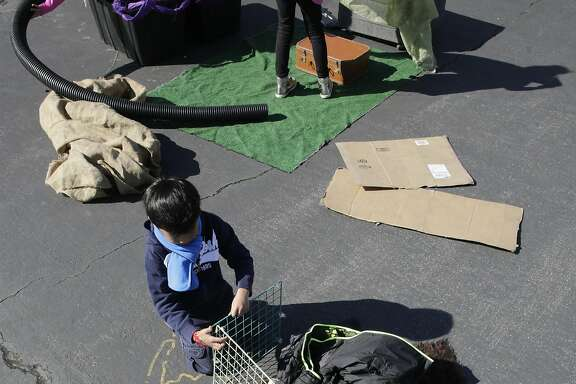 1st grader Jonathan Ruiz found a place to relax during recess at William G. Paden Elementary School on Wed. March 8, 2017, in Alameda, Ca.  Administrators and volunteers collect recyclable items from throughout the community to encourage students to create their own activities and games during recess time.