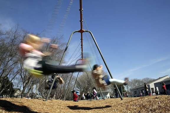Kindergartner Elaine Kiewlich swings during recess at Bay Farm Elementary School on Wed. March 8, 2017, in Alameda, Ca.