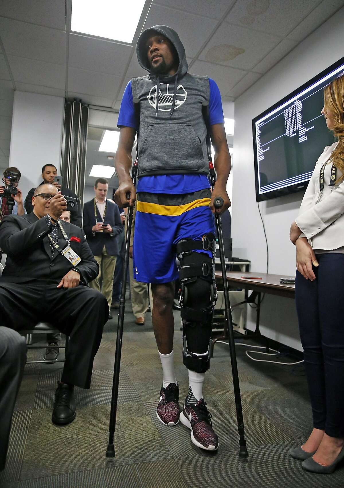 Golden State Warriors' Kevin Durant arrives for press conference about his injured left knee before Warriors play Boston Celtics in NBA game at Oracle Arena in Oakland, Calif., on Wednesday, March 8, 2017.