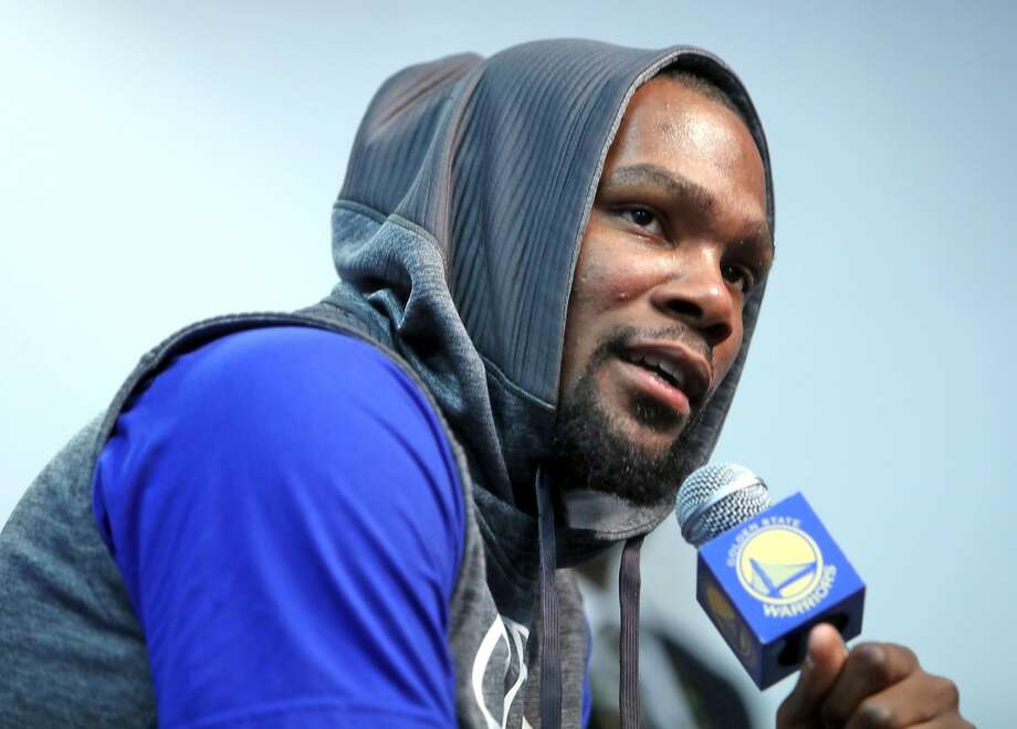 Golden State Warriors' Kevin Durant speaks at press conference about his injured left knee before Warriors play Boston Celtics in NBA game at Oracle Arena in Oakland, Calif., on Wednesday, March 8, 2017. Photo: Scott Strazzante, The Chronicle