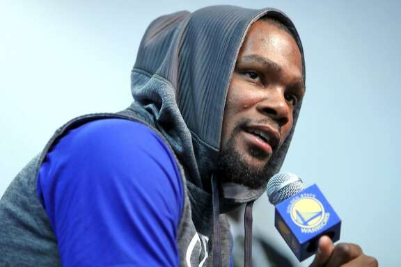 Golden State Warriors' Kevin Durant speaks at press conference about his injured left knee before Warriors play Boston Celtics in NBA game at Oracle Arena in Oakland, Calif., on Wednesday, March 8, 2017.