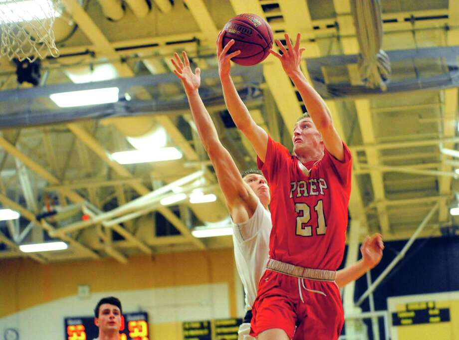 Fairfield Prep's Briane Noone lays up the ball to score two points as Trumbull's Ryan Roberto defends during CIAC Class LL Boys Basketball action in Trumbull, Conn., on Wednesday Mar. 8, 2017. Photo: Christian Abraham / Hearst Connecticut Media / Connecticut Post