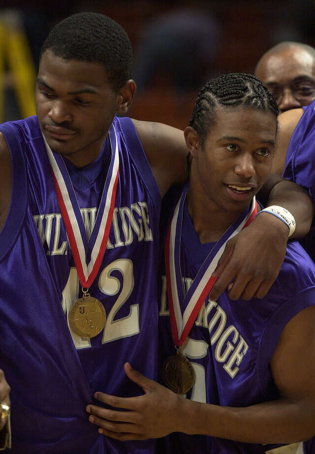 Willowridge's T.J. Ford (5) and teammate Isaac Watson (42) enjoy their medals after winning the 5A state championship game, Saturday, March 10, 2001 at Frank Erwin Center in Austin.  Willowridge's Curtis Walker won the MVP of the tournament. Willowridge won 65-58. CHRISTOBAL PEREZ/HOUSTON CHRONICLE.  HOUCHRON CAPTION (03/12/2001):  Willowridge's Isaac Rollins, left, and T.J. Ford were as good as gold in Class 5A for the second year in a row. Photo: CHRISTOBAL PEREZ, STF / HOUSTON CHRONICLE