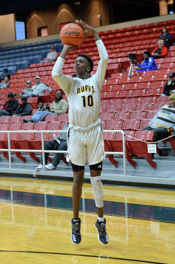 Jabari Rice (10) of Marshall makes a 3-point attempt during the first half of a basketball game between the Ft. Bend Marshall Buffalos and the Arlington Bowie Volunteers at the Ft. Bend ISD Tournament on Friday December 9, 2016, Wheeler Fieldhouse, Sugar Land, TX. Photo: Craig Moseley, Staff / ©2016 Houston Chronicle