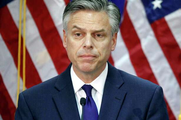 FILE - In this Jan. 16, 2012, file photo, former Utah Gov. Jon Huntsman, announces he is ending his campaign for president in Myrtle Beach, S.C. A White House official says Huntsman is President Donald Trump's choice to be the next U.S. ambassador to Russia. Huntsman will take the diplomatic post as senior members of Trump's administration face questions about their contact with the Russian government. (AP Photo/Charles Dharapak, File)