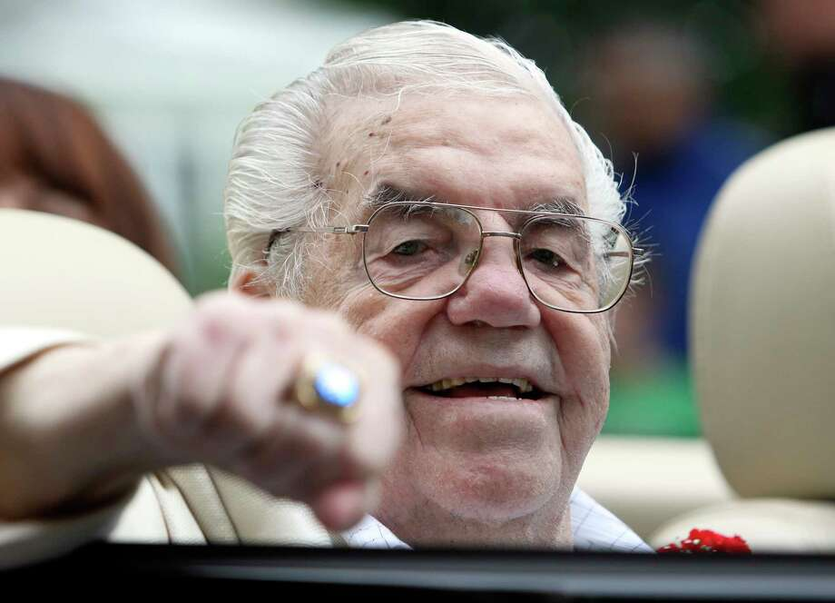 FILE - In this June 12, 2011, file photo, Lou Duva gestures at the Boxing Hall of Fame parade in Canastota, N.Y. The Boxing Hall of Famer trainer, who handled the careers of 19 champions including heavyweight titlist Evander Holyfield, died Wednesday, March 8, 2017, of of natural causes at a hospital in Paterson, N.J., where he lived,  his son Dino said. He was 94. (AP Photo/Mike Groll, File) ORG XMIT: NY187 Photo: Mike Groll / AP2011