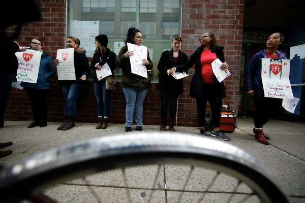 """Teachers take part in a """"A Day Without A Woman"""" demonstration outside the Science Leadership Academy in Philadelphia, Wednesday, March 8, 2017. Organizers of January's Women's March are calling on women to stay home from work and not spend money in stores or online to show their impact on American society. (AP Photo/Matt Rourke)"""