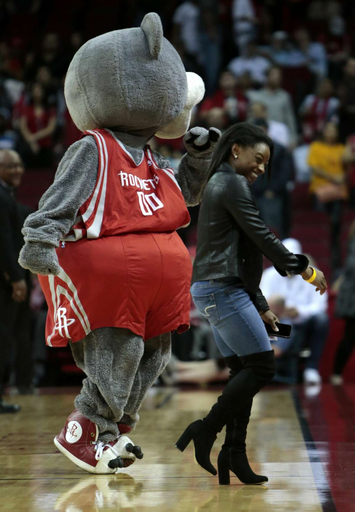 Olympic gold medalist Simone Biles, right, dances with Houston Rockets mascot Clutch during a time out in the fourth quarter of an NBA basketball game between the Rockets and the Utah Jazz at Toyota Center on Wednesday, March 8, 2017, in Houston. ( Brett Coomer / Houston Chronicle )