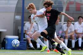 TMI midfielder Joseph Kuri, right, had a total of eight goals and three assists in wins over Boerne and Holy Cross.