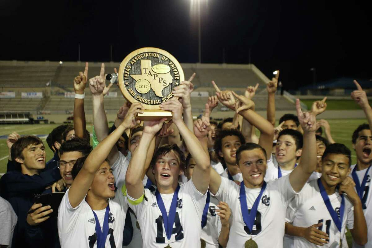 Central Catholic players celebrate with their state championship trophy after defeating Houston St. Pius 6-1 in the TAPPS Division I match at Waco ISD Stadium on March 8, 2017 in Waco, Texas.