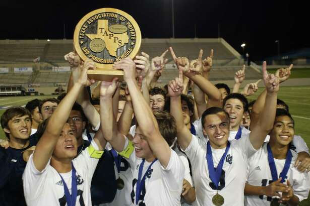 San Antonio Central Catholic players celebrate with  their State Championship trophy over Houston St. Pius during the second half of a High School Soccer TAPPS Division I State Championship at WacoISD Stadium on  March 8, 2017 in Waco, Texas. Centraal Texas Won 6-1. Jose Yau/Special Contributor