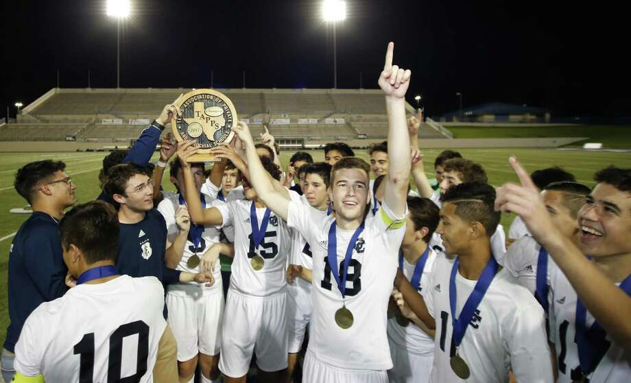 Central Catholic players celebrate with their TAPPS Division I state championship soccer trophy at Waco ISD Stadium on March 8, 2017 in Waco. Photo: Jose Yau /For The Express-News