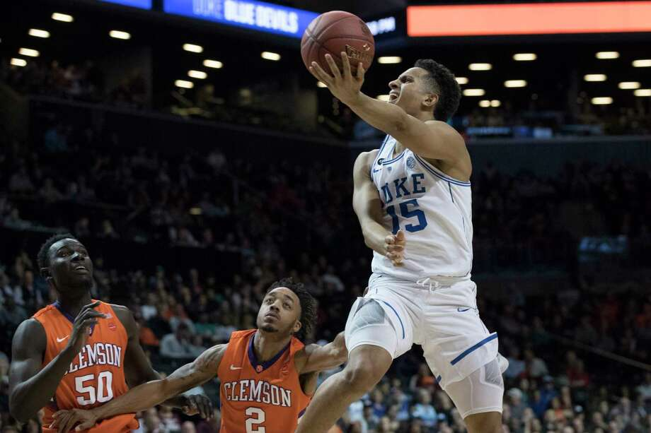 Duke guard Frank Jackson (15) goes to the basket past Clemson center Sidy Djitte (50) and guard Marcquise Reed (2) during the second half of an NCAA college basketball game in the Atlantic Coast Conference tournament, Wednesday, March 8, 2017, in New York. Duke won 79-72. (AP Photo/Mary Altaffer) ORG XMIT: NYMA123 Photo: Mary Altaffer / Copyright 2017 The Associated Press. All rights reserved.