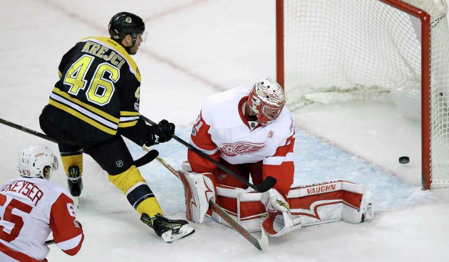 Boston Bruins center David Krejci (46) pokes the puck past Detroit Red Wings goalie Jared Coreau (31) for a goal during the first period of an NHL hockey game in Boston, Wednesday, March 8, 2017. (AP Photo/Charles Krupa) ORG XMIT: MACK102 Photo: Charles Krupa / Copyright 2017 The Associated Press. All rights reserved.