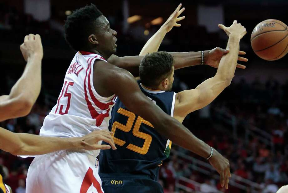 Center Clint Capela, left, and the Rockets couldn't quite hold off guard Raul Neto and the Jazz. Photo: Brett Coomer, Staff / © 2017 Houston Chronicle