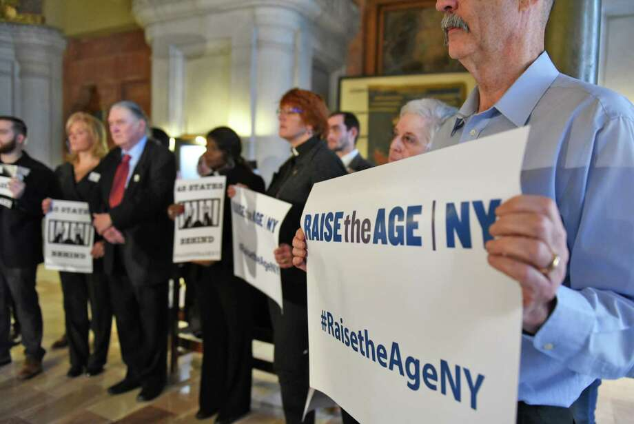 Demonstrators hold a Raise the Age rally with clergy in War Room at the Capitol as the 2017 session of the NYS Legislature begins Wednesday Jan. 4, 2017 in Albany, NY.   (John Carl D'Annibale / Times Union) Photo: John Carl D'Annibale / 20039119A