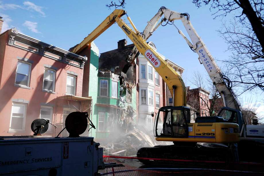 Crews work on demolishing the building located at 168 Fourth Street on Wednesday, March 8, 2017, in Troy, N.Y.  The building had been extensively damaged by a fire on Tuesday.    (Paul Buckowski / Times Union) Photo: PAUL BUCKOWSKI / 20039902A