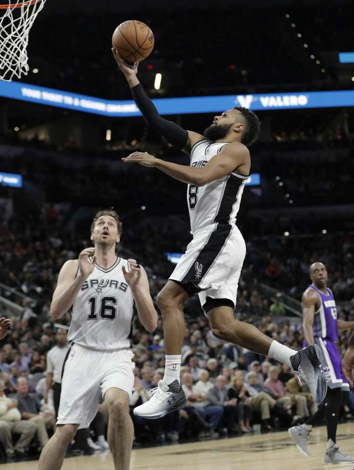 San Antonio Spurs guard Patty Mills (8) drives to the basket past teammate Pau Gasol (16) during the second half of the team's NBA basketball game against the Sacramento Kings, Wednesday, March 8, 2017, in San Antonio. San Antonio won 114-104. (AP Photo/Eric Gay) Photo: Eric Gay/Associated Press