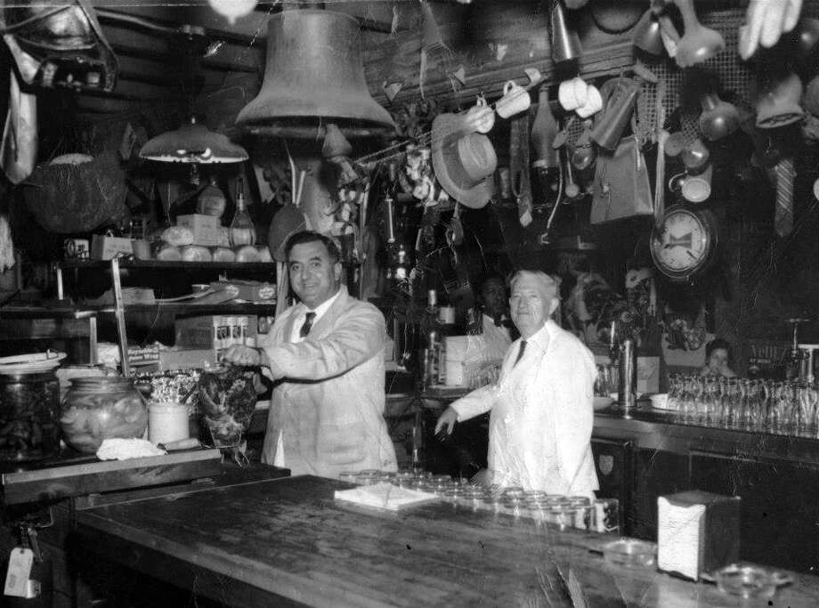 """Charlie Vergos, left, and his father's Greek-influenced rub for pork ribs became known as the Memphis """"dry"""" style in the 1950s.  at Charlie Vergos Rendezvous in Memphis in the 1950s. MUST CREDIT: Charlie Vergos Rendezvous. / Charlie Vergos Rendezvous"""