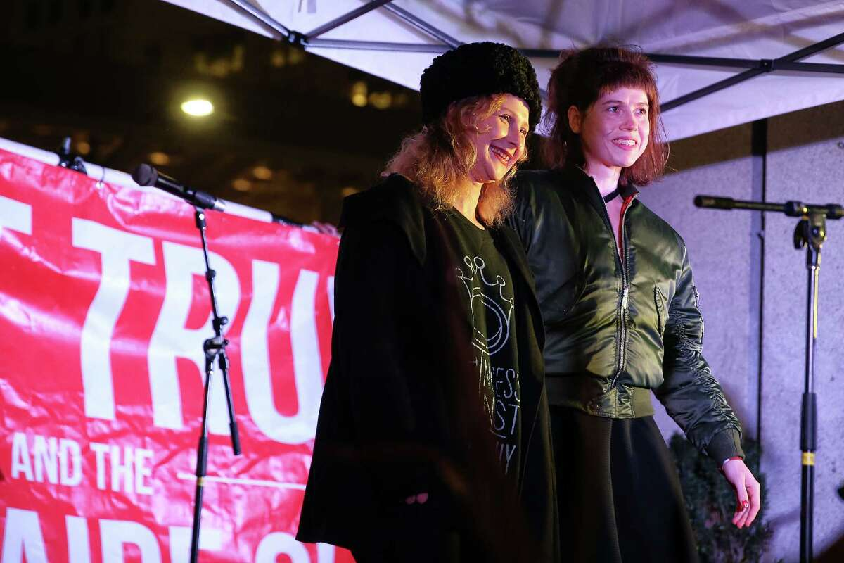 Pussy Riot members Maria Alyokhina, left, and Nadezhda Tolokonnikova stand onstage during a rally for women's rights on International Women's Day.
