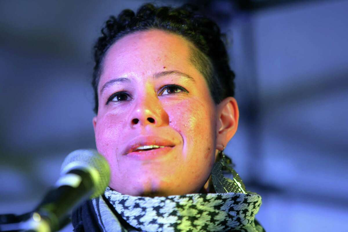 Black Lives Matter activist Nikkita Oliver, who recently announced she is running for mayor of Seattle, speaks to a crowd during a rally for women's rights on International Women's Day, Wednesday, March 8, 2017, at Westlake Park.