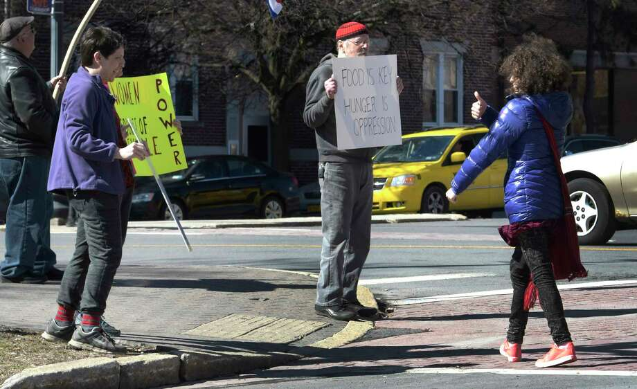 Demonstrator Rosie Huttner of Resist for Repro gives the thumbs up sign as she arrives for a demonstration by various groups for Women's Day at Townsend Park Wednesday  March. 8, 2017 in Albany, N.Y. (Skip Dickstein/Times Union) Photo: SKIP DICKSTEIN / 20039892A