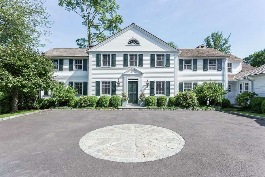 The Connecticut colonial house at 256 Brookside Road was built in 1948 but was later updated to accommodate modern living with an in-ground swimming pool and cabana, outdoor shower, guest house, and attractive gardens. Photo: Contributed Photos