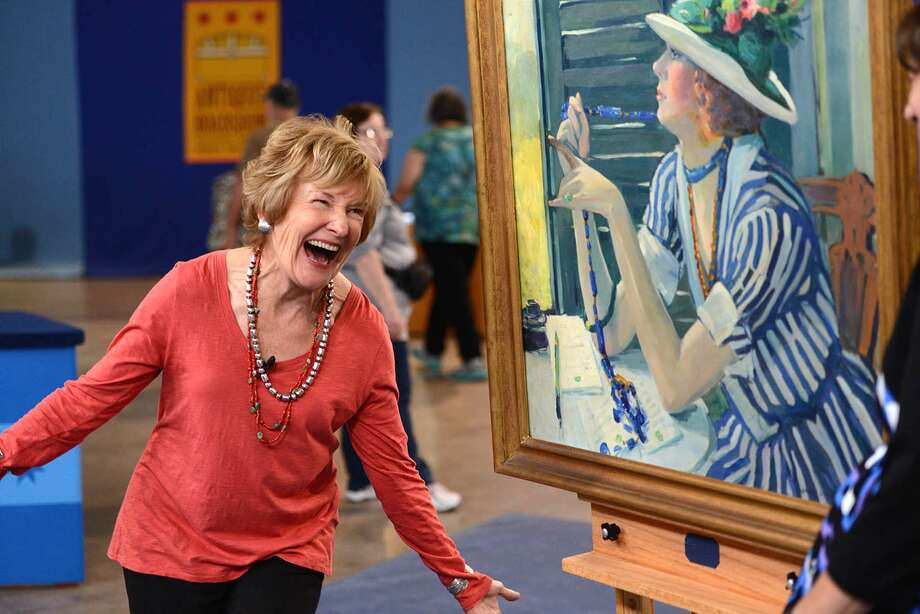 A guest learns the price of her painting. Photo: For The Edge