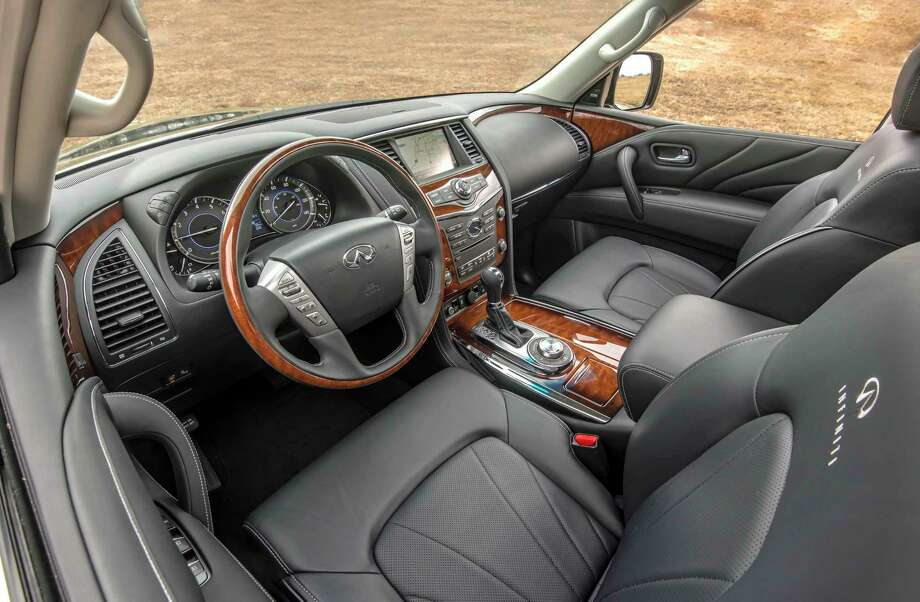 The 2017 Infiniti QX80 Limited Package brings semi-aniline Truffle Brown leather upholstery with a unique quilted pattern, matte-finish ash wood trim, Ultrasuede headliner and door pillars, leather-covered grab handles and speaker grilles, unique floor and trunk mats, and unique silver trim on the center instrument stack. Photo: Nissan / Nissan