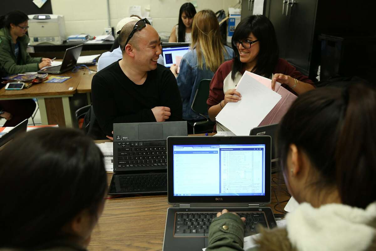 From center right: Jasmine Ponce De Leon, a VITA volunteer, helps student Chris Wong prepare his tax return at San Francisco State University on Wednesday, March 8, 2017, in San Francisco, Calif. The IRS offers a Volunteer Income Tax Assistance (VITA) program, where volunteers help with tax returns for free to people who generally make $54,000 or less. Wong is an SFSU student and has used VITA for the last three years.