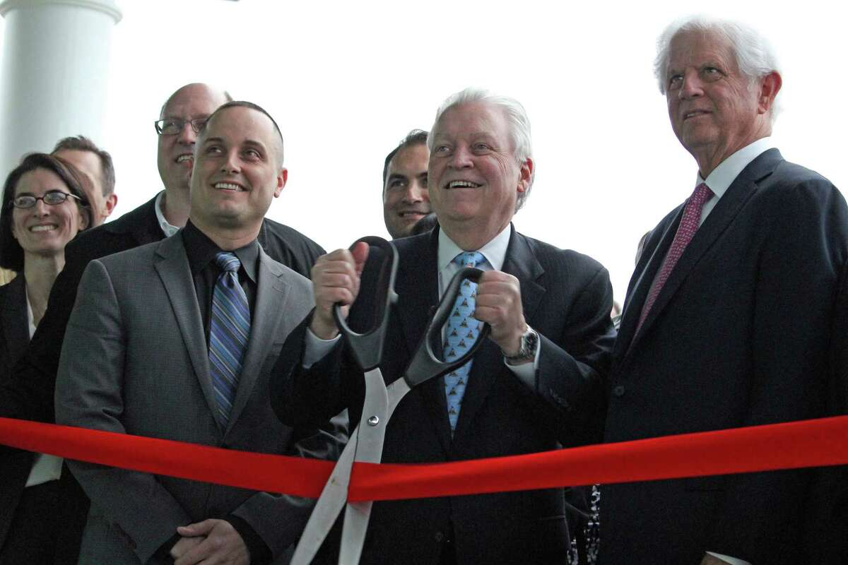 Interim Recreation Director Anthony Calabrese, left, joined First Selectman Mike Tetreau, center, and James Bradley, chairman of the Penfield Building Committee, at the pavilion's official re-opening Tuesday.