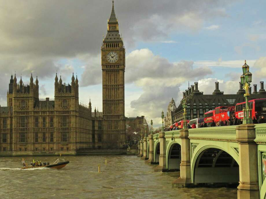 With Big Ben in the background and visitors and double-decker buses crowding the Westminster Bridge, a boat cruises down the River Thames, which provides a bounty of angling opportunities. Photo: John Goodspeed /For The Express-News