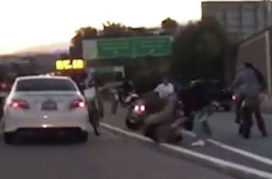 A group of dirt bike riders appear to vandalize a car and assault a  driver on southbound Hwy. 101 at the Cesar Chavez St. in San Francisco  Wednesday, March 8, 2017. Photo: Courtesy Video