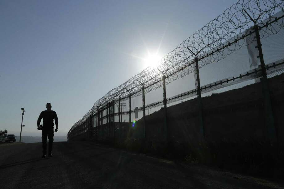FILE--In this June 22, 2016, file photo, a Border Patrol agent walks along a border structure in San Diego, Calif. The U.S. Border Patrol's parent agency may exempt many veterans and law enforcement officers from a requirement that new hires take a lie-detector test. (AP Photo/Gregory Bull, file) Photo: Gregory Bull, STF / Associated Press / Copyright 2017 The Associated Press. All rights reserved.