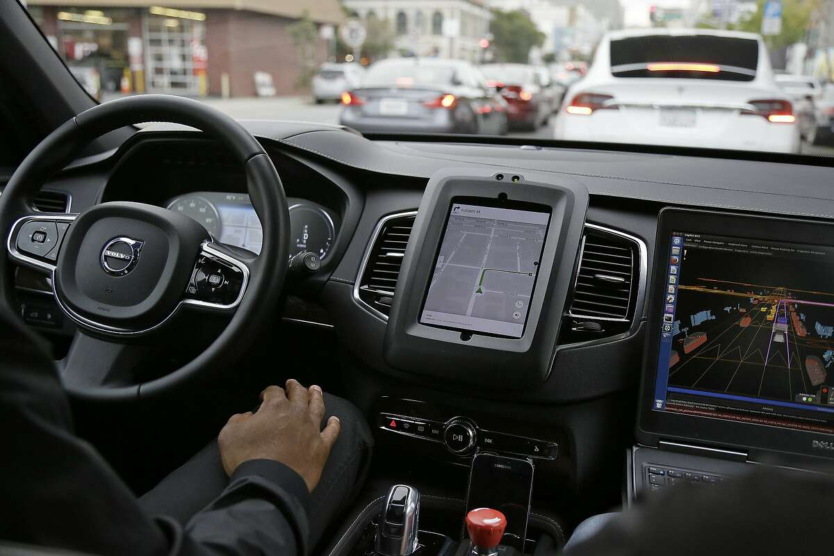 In this file photo, an Uber car in driverless mode waits in traffic during a test drive in San Francisco. Uber's self-driving cars will return to California's streets. But the company doesn't plan to pick up passengers for now. The California Department of Motor Vehicles said Wednesday, March 8, 2017, it has granted Uber permission to run two Volvo SUVs on public roads. (AP Photo/Eric Risberg, File)